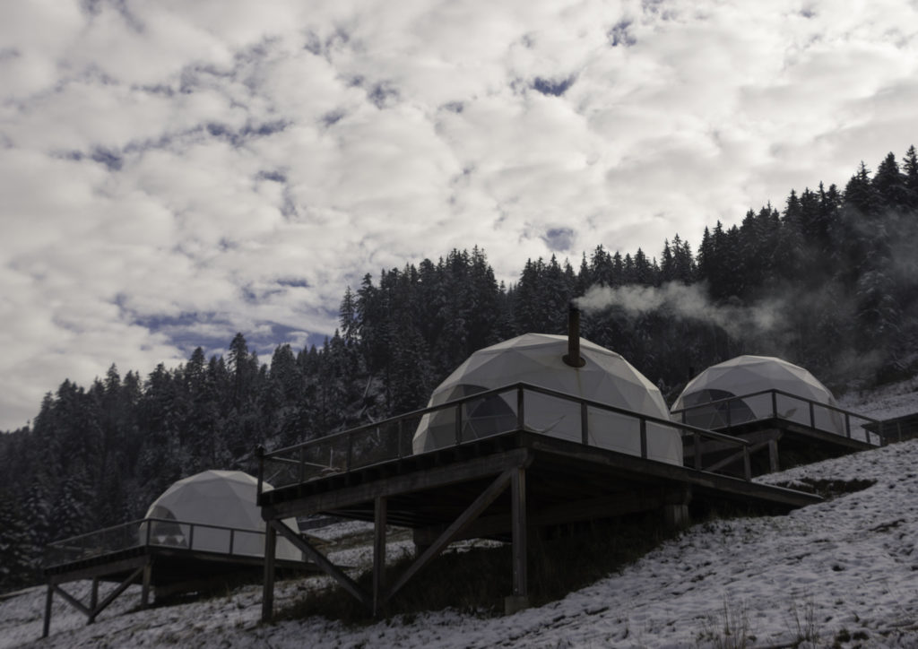 Whitepod eco-lodges in the forest with snow in Monthey Switzerland