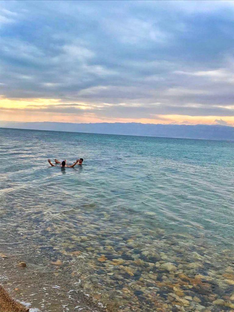 two men relaxing on the Dead Sea in Jordan