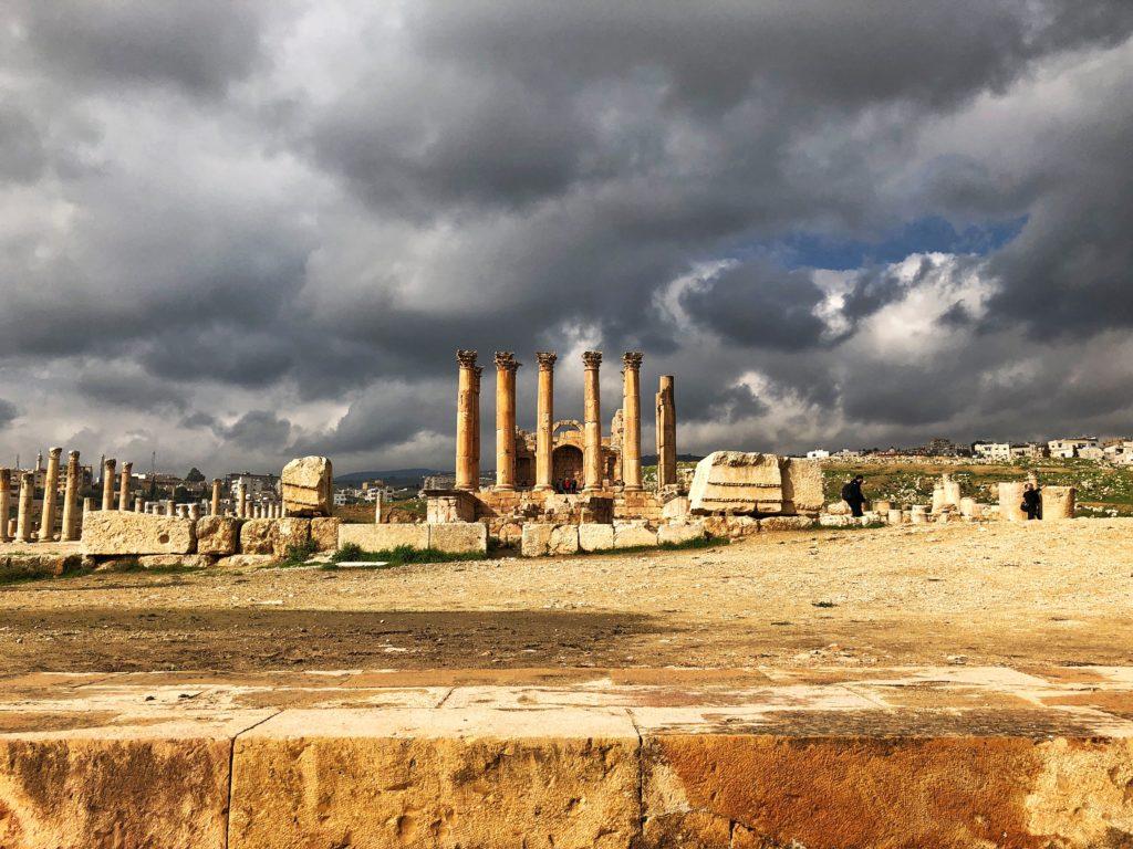 Ruins of a temple with a sky full of dark clouds in Jerash Jordan