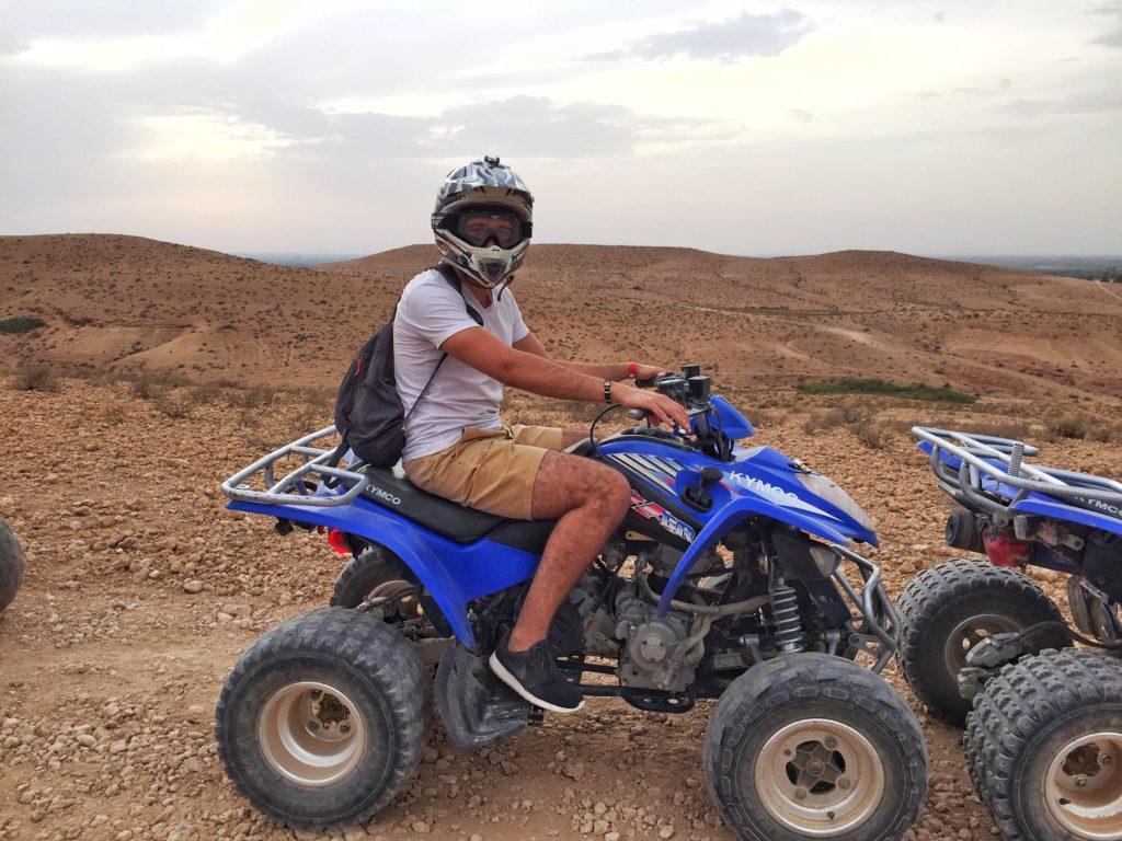 Man riding an ATV in the desert in Dubai