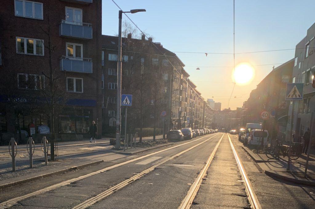 grunnerløkka street with the sun in Oslo Norway